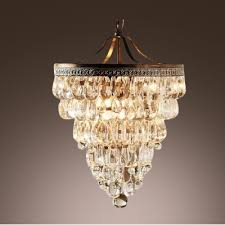 contemporary chandelier based on trim of vintage motorcycles embellished with clear and teardrops create energizing