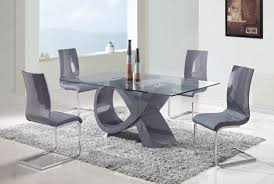 modern acrylic dining table plus gray chairs on fur rug near fix glass  window design