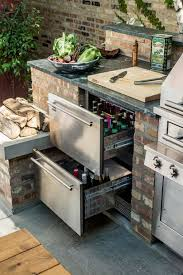 this outside kitchen setup shows that you don t desire a lot of outside space for a kitchen that is functional and fashionable a two refrigerator door