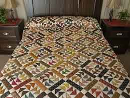 Dutchmans Puzzle Quilt -- magnificent meticulously made Amish ... & Dutchmans Puzzle Queen Size Bed Quilt Photo ... Adamdwight.com