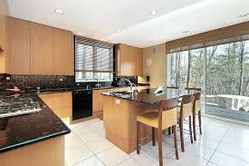 light oak kitchen cabinets black contrast with brightly toned smooth wood cabinets and white tile floor