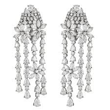 white gold chandelier earrings with round and fancy cut diamonds