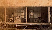 Winifred Rawson tending her son on the veranda of The Hollow, near Mackay,  Queensland, ~1873