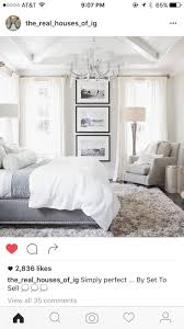 White bedroom with a chandelier