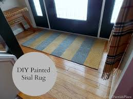 i have been wanting to try my hand at painting a rug for quite some time and i finally did it here it is in my entry