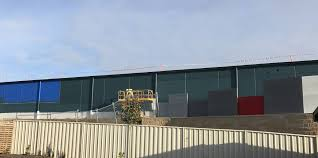 paint job the new bunnings warehouse in devonport has been painted green as work continues
