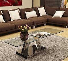 Modern glass top coffee table with wooden legs: 20 Inimitable Styles Of Swiveling Glass Coffee Table Home Design Lover