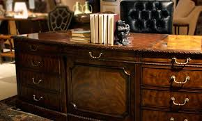 antique reion desk shown in a traditional office
