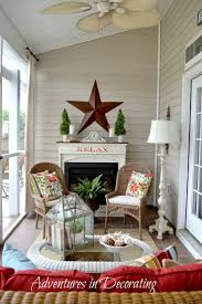 I love the way the small porch is decorated to make it look bigger, having  the fireplace at the end wall elongates the small room.
