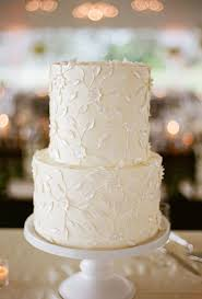 White Wedding Cake With All Over Floral Details Brides