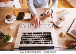 beautiful bright office. Top View Of Designer Woman Buying Online With The Card While Sitting In Beautiful Bright Office