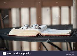 deck wrought iron table. A Pair Of Reading Glasses Lies On Top An Open Bible Laying A Wrought  Iron Table Wooden Deck With Matching Chairs.