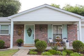 aqua craftsman style shutters on brick ranch house