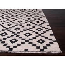 scandi jet black flat weave rug corner detail