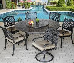 nassau outdoor patio 7pc dining set with series 5000 71 round dining table includes 2 swivel rockers 35 lazy susan seat cushions antique bronze