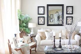 wonderful wall decor for pleasing living room ideas with white sectional sofa and rectangle glass top coffee table also black frame wall art mirror plus