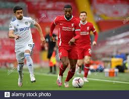 Leeds United's Pablo Hernandez (left) and Liverpool's Georginio Wijnaldum  in action during the Premier League match at Anfield, Liverpool Stock Photo  - Alamy