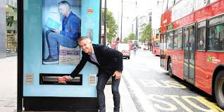 Twitter Powered Vending Machine Impressive Walkers Transforms London Bus Stops Into Tweetactivated Vending