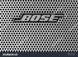 bose logo white. leeds - june 01: bose logo on a speaker grill, image processed in black white