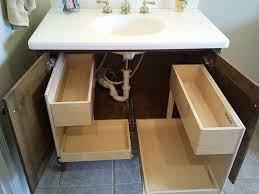 a bathroom vanity floor plumbing