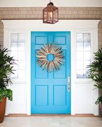 blue front door with driftwood wreath
