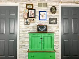 dark gray painted interior doors with plank walls