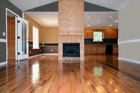 engineered hardwood uses a thin strip of natural wood as the top layer instead of a printed image