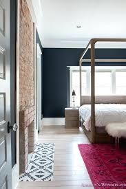 hardwood flooring on walls master bedroom black walls white wood bead chandelier whitewashed hardwood flooring four hardwood flooring