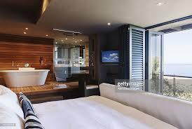 modern bedroom with bathroom. Perfect Bedroom Modern Master Bedroom And Bathroom Overlooking Ocean With Bedroom Bathroom