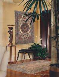 antique ferahan sarouk rug displayed on the wall