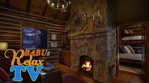 cozy log cabin wind ling fireplace sounds and snow falling outside