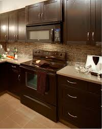 kitchen backsplash glass tile dark cabinets. Unique Cabinets Modern Kitchen With Glass Mosaic Backsplash Taupe Floor Tile Dark Cabinets  Black Appliances Light Countertop And Brushed Steel Hardware With Kitchen Backsplash Glass Tile Dark Cabinets N