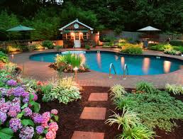 Pretty Backyard Pool Landscaping With Beautiful Flower