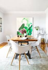 modern dining room design with a white pale gray and tan color scheme featuring