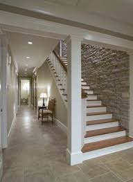 Love the stone wall down the basement stairs --- Staircase Design, Pictures,