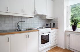 renew white kitchen cabinet in beautiful apartment interior design