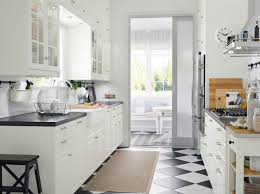 white ikea kitchen black countertops checkerboard floor black and white kitchen