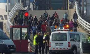 Hasil gambar untuk migrants storm ferry calais