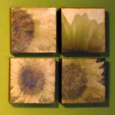 if you can use mod podge then you can make these diy sunflower wall art panels on diy sunflower wall art with pretty and easy diy sunflower wall art mod podge rocks