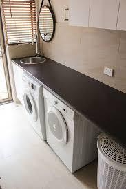 prime time oak laminate finish laundry idea laundry tops laundry cupboards laundry ideas