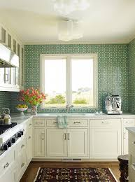 white kitchen with green mosaic tile backsplash