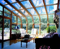 furniture excellent contemporary sunroom design. Attractive Curved Eave Modern Sunroom Design With Glass Windows Wall And Wood Framed Also Puffy Sofa Glamorous Contemporary Framing Furniture Excellent