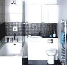 a sink and toilet combo with a black countertop