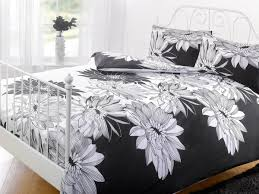 creative bedroom with sidetable and laminate flooring plus curtains and duvet covers