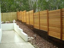 build a fence on a slope horizontal timber fence with sleeper base build fence on sloped build a fence on a slope