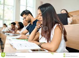 student sitting at desk side view. Fine Sitting Sideview Of Young Student Prepearing For Exams In University Inside Student Sitting At Desk Side View T