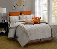 simple modern bedroom with big rectangle pillows orange white colors a bedcover bed