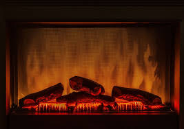 closeup of electric artificial fireplace with orange fire flame interior