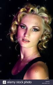 dramatic studio lighting. A Beauty Model Poses Fiercely In Dramatic Studio Lighting, With Marilyn Monroe Inspired Hair Lighting