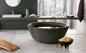 free standing bathtub round natural stone